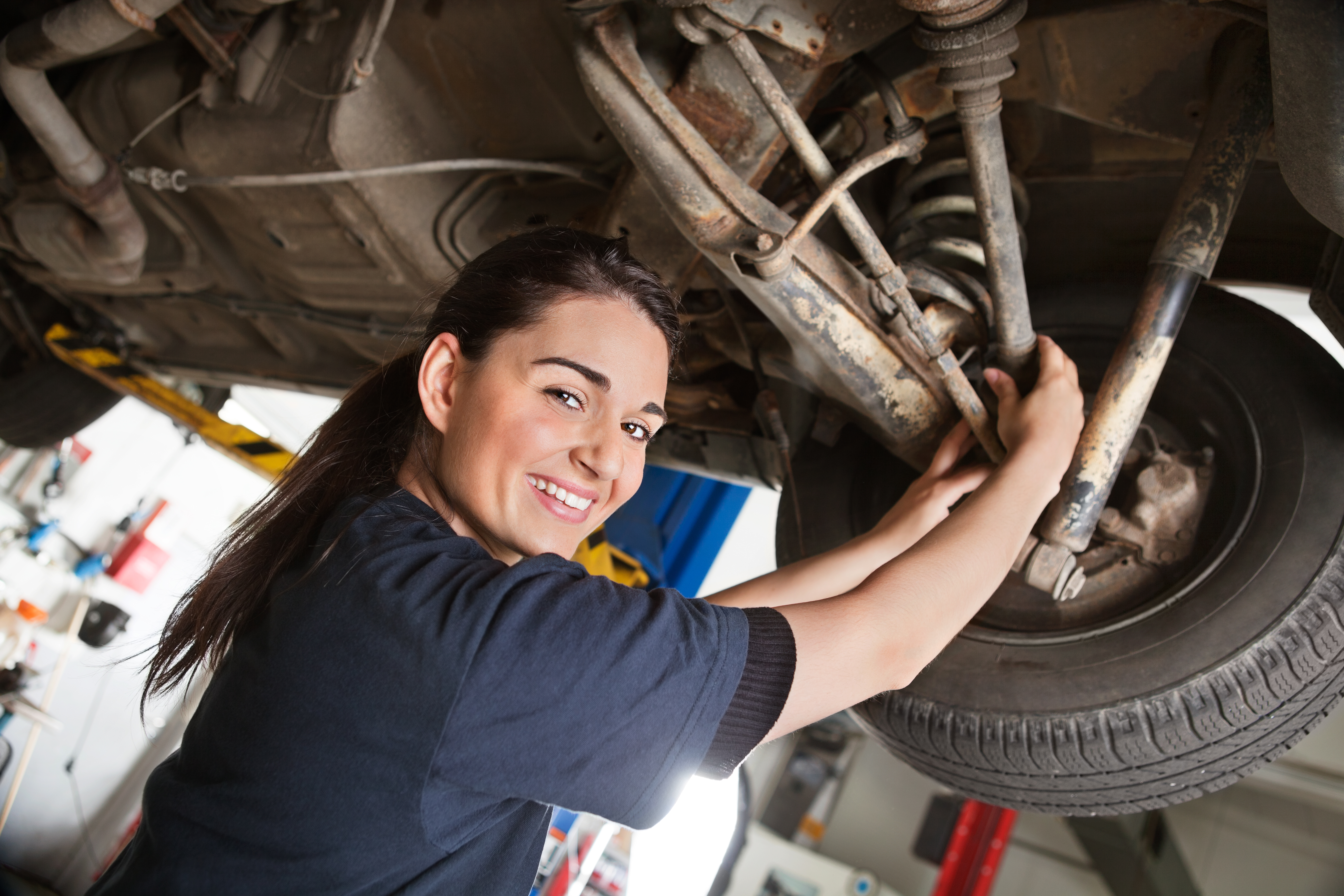 1930237-portrait-of-smiling-young-female-mechanic.jpg
