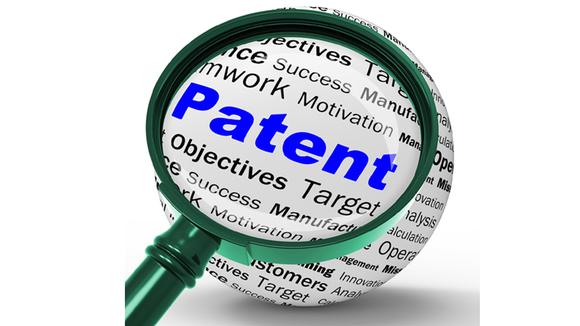 Förstoringsglas som visar ordet patent