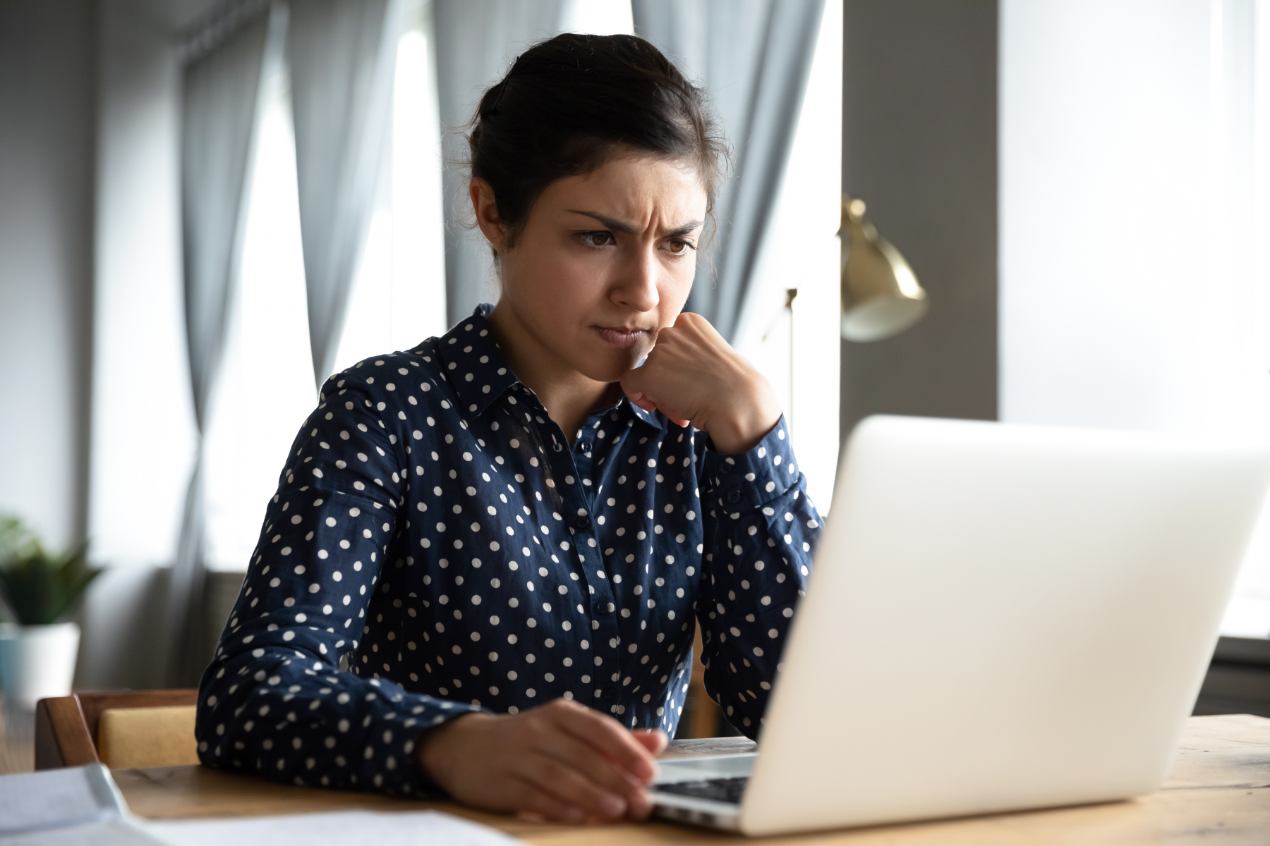 35331271-concerned-indian-woman-look-at-laptop-frustrated-about