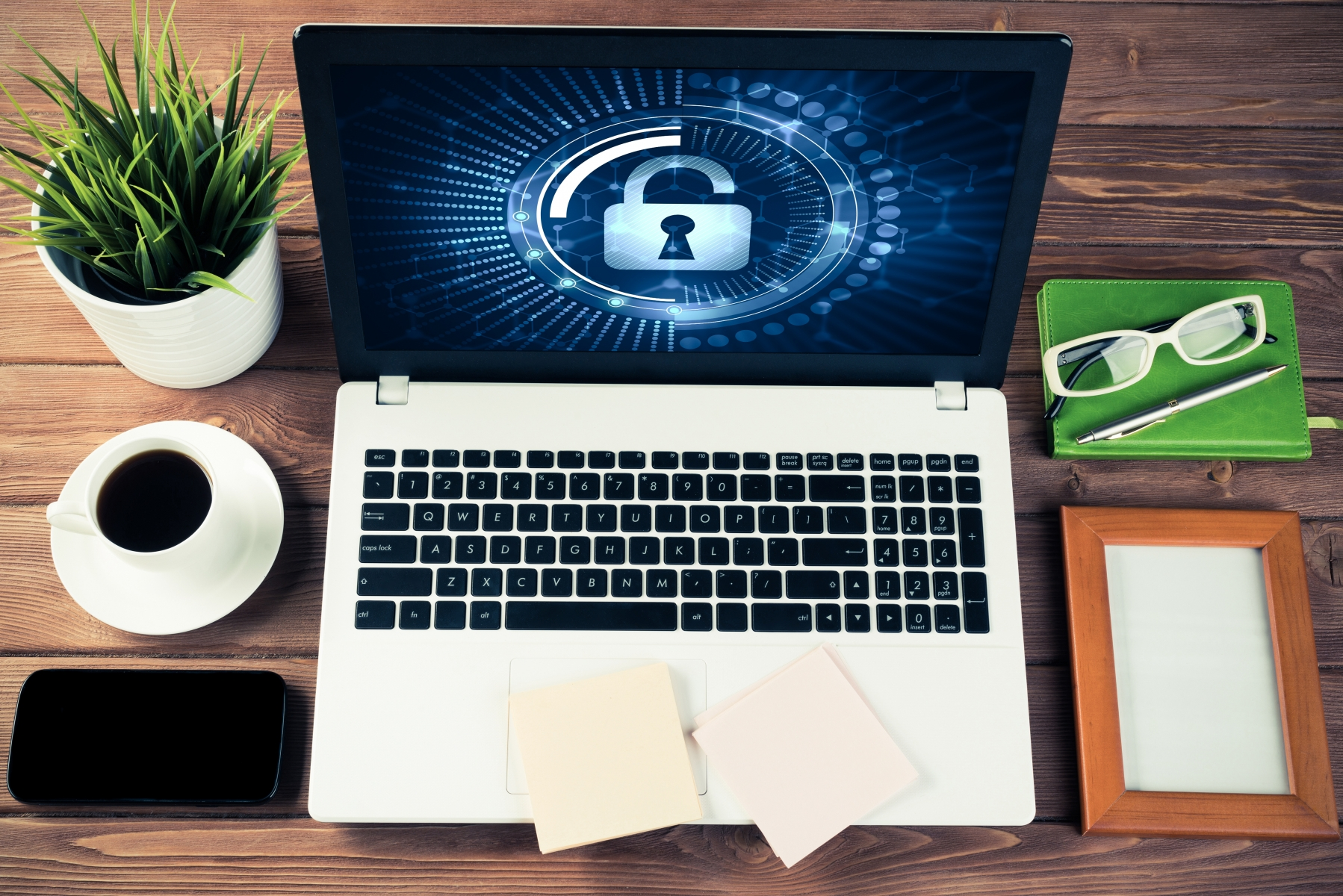 23337669-web-security-and-technology-concept-with-laptop-on-wooden-table