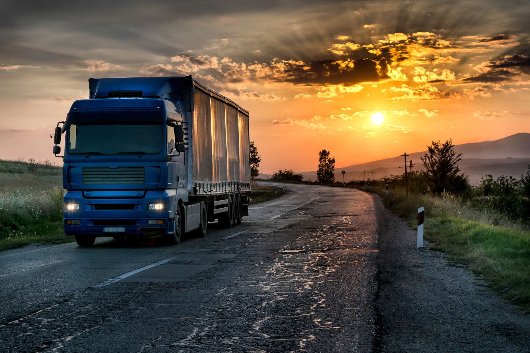 22973647-blue-lorry-on-the-asphalt-rural-road