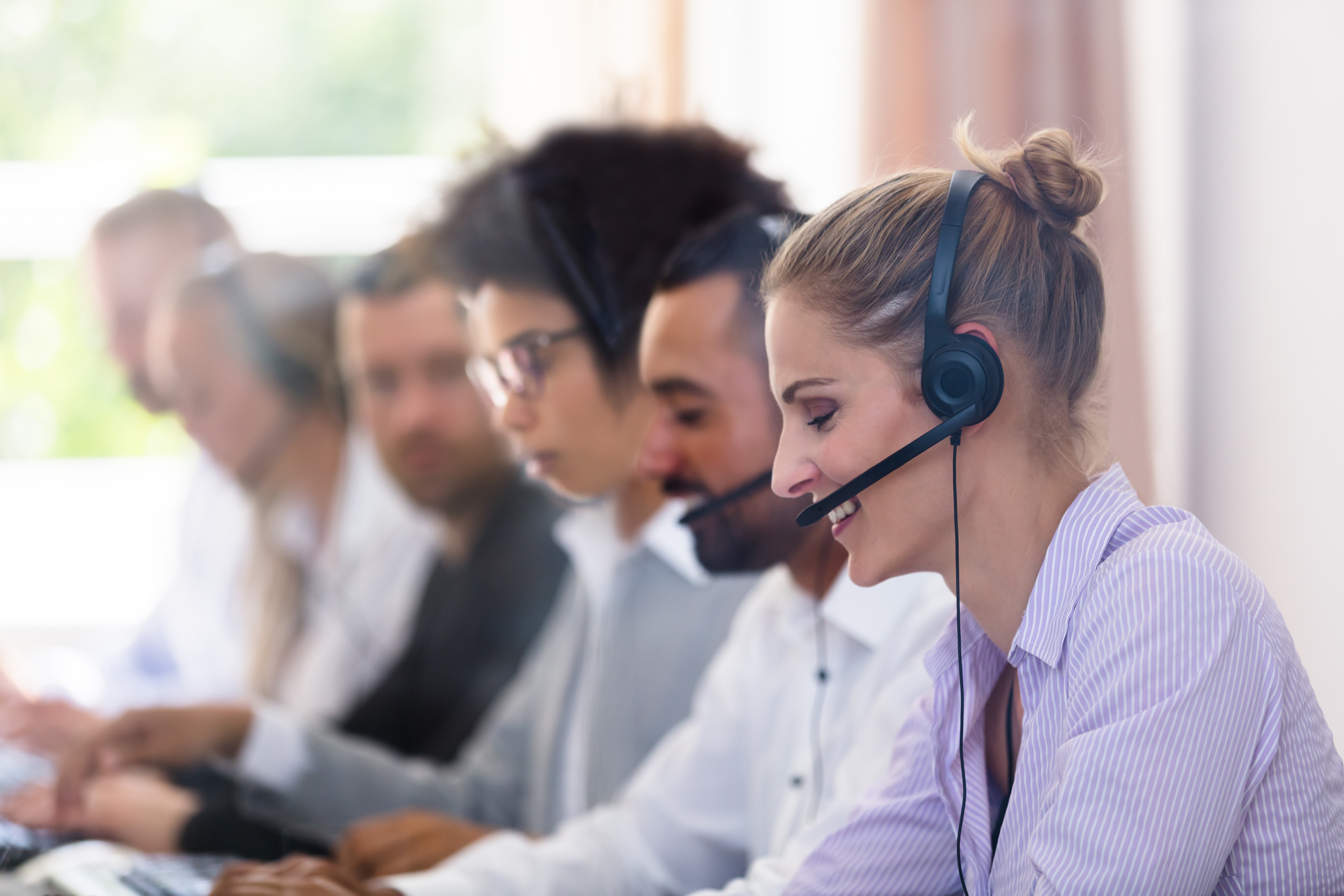 27079064-customer-service-executives-working-in-call-center