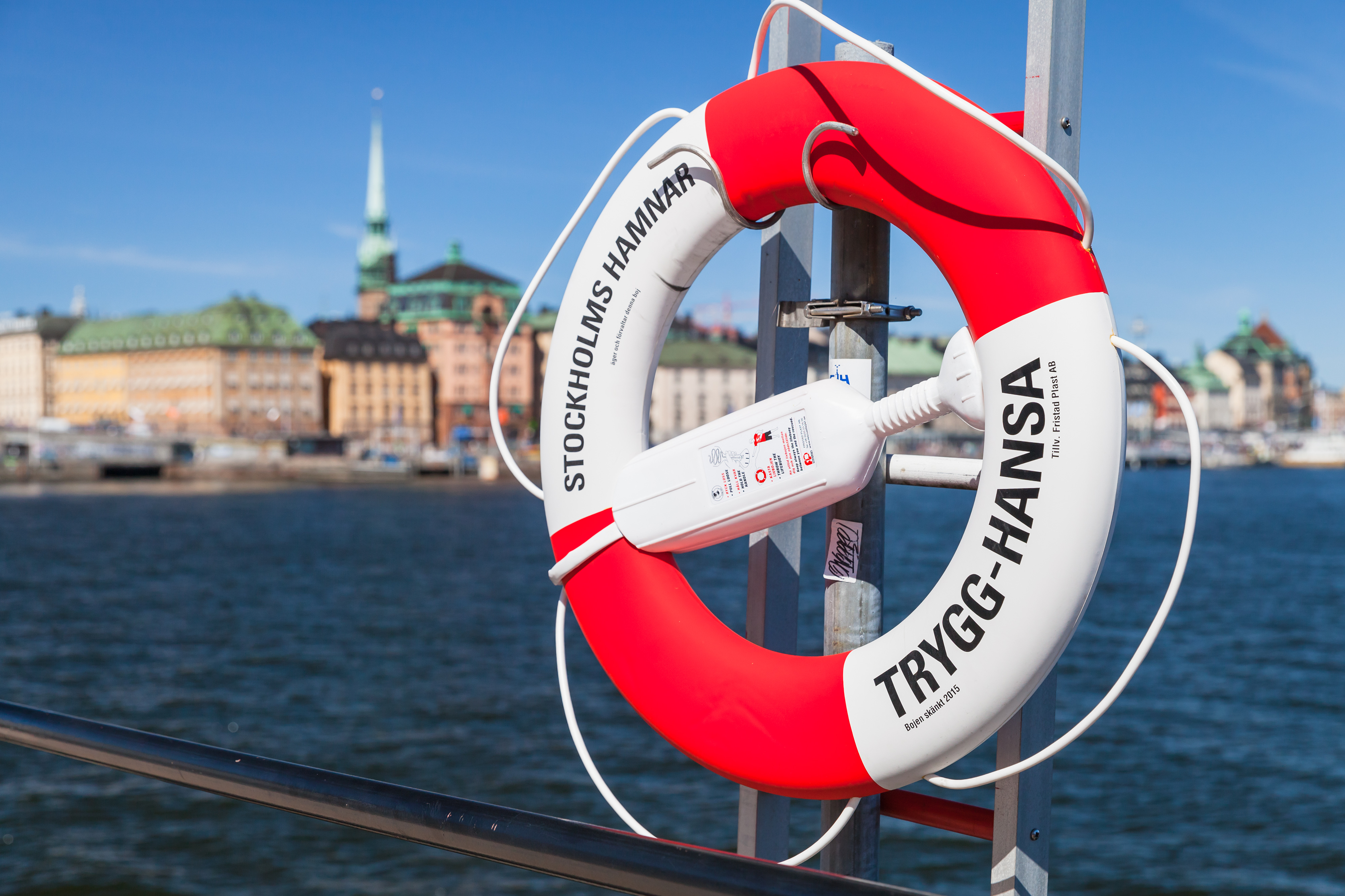 16718630-red-and-white-ring-buoy-in-stockholm