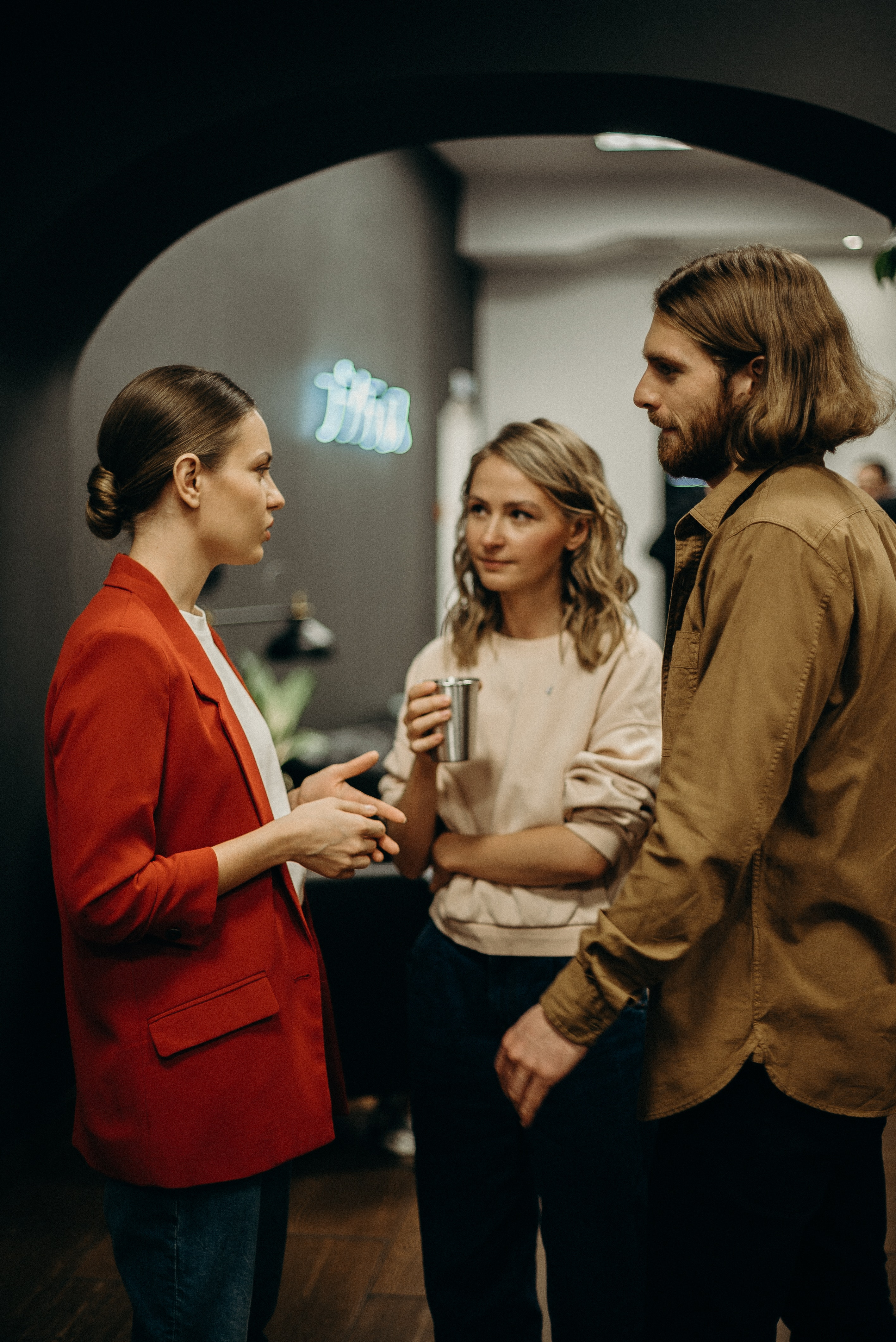 two-women-and-man-talking-3201718