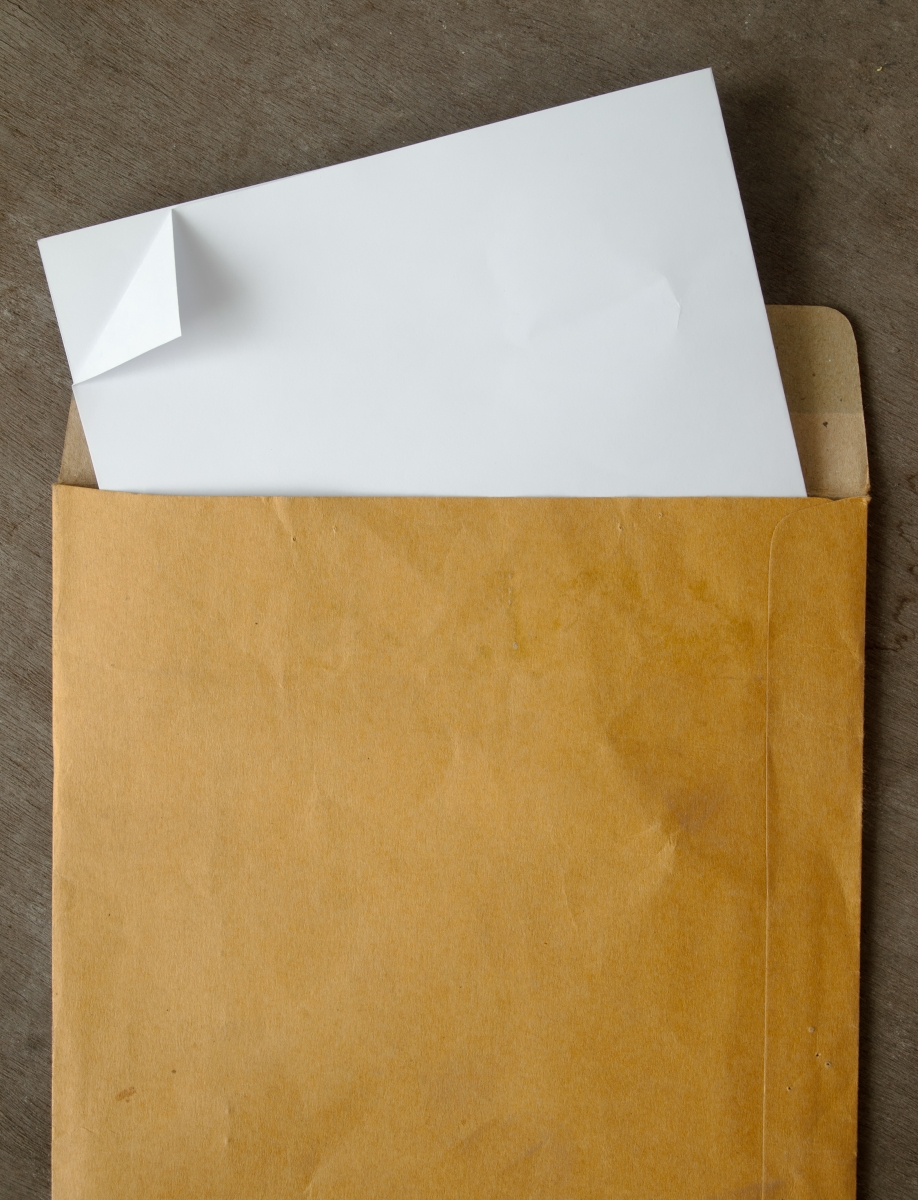 2447390-white-paper-from-a-brown-open-envelope