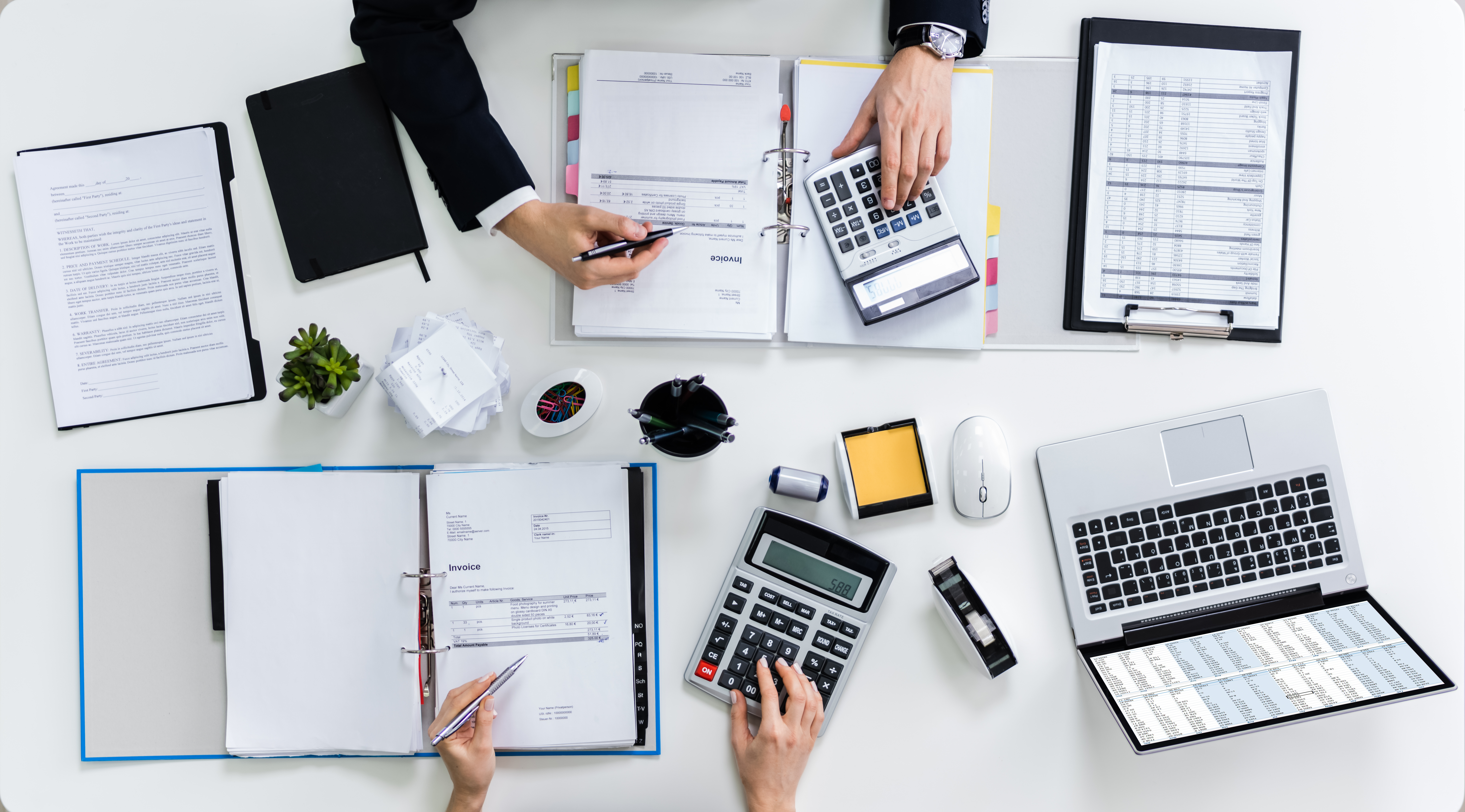 36401155-two-businesspeople-calculating-bills-in-office