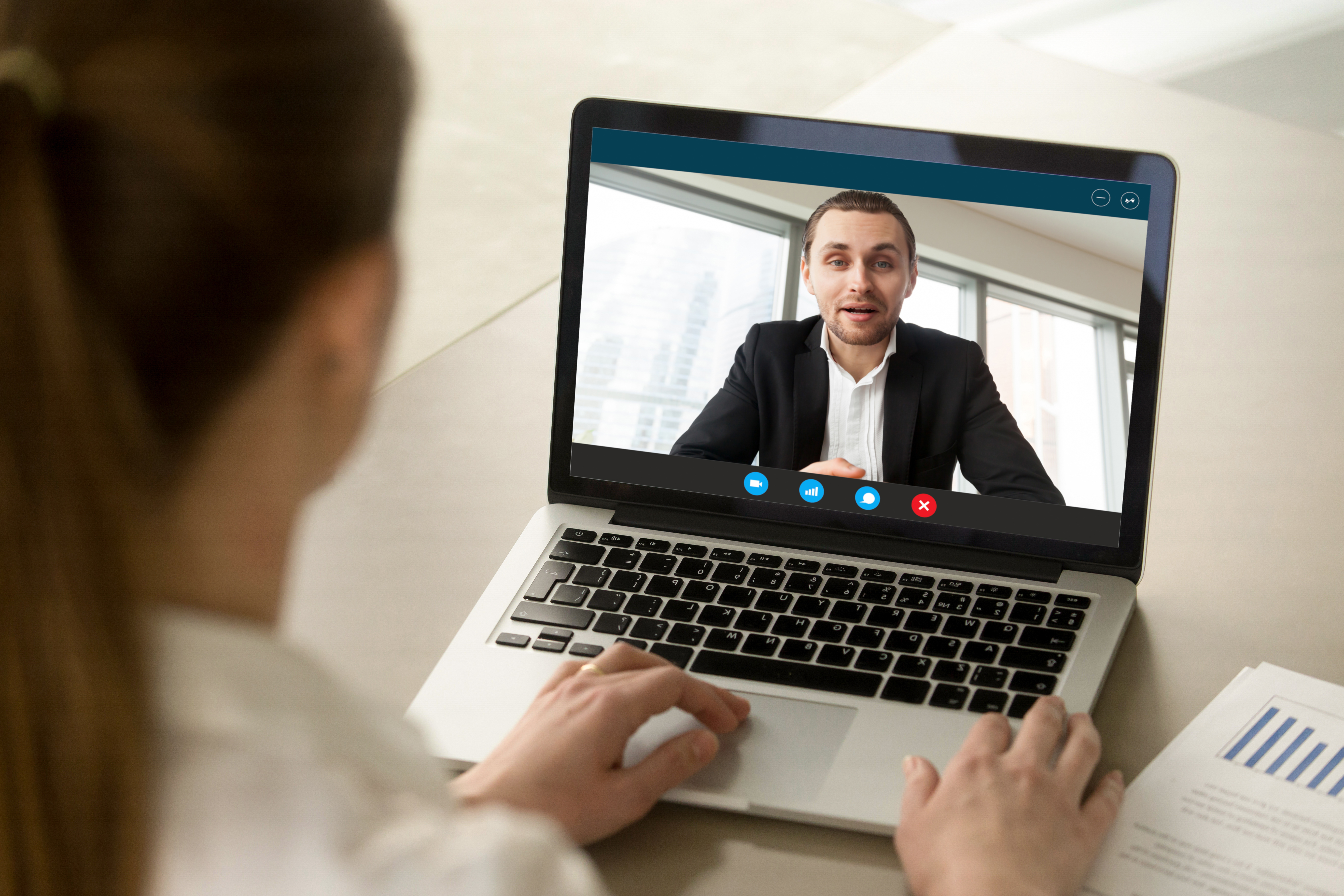 36863167-female-employee-talk-with-boss-on-video-call